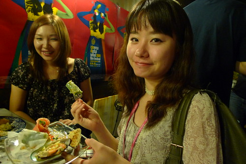Miyonne eating, Tomoko in background