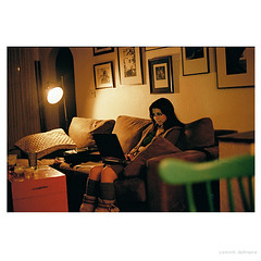 my sister in Denver on her computer (Yannick Delmaire) Tags: light usa color film lamp vintage chair boots denver couch tina unretouched analogue nit argentique yannick delmaire yannickdelmaire