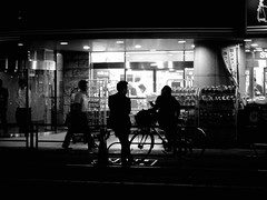 44/365: Jay and Silent Bob (joyjwaller) Tags: blackandwhite bicycle japan tokyo neon darkness streetlife takadanobaba conveniencestore conbini japanesemen aharddaysnight project365 unearnedreferencestopopularfilms
