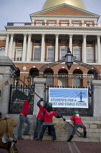 The Leadership Campaign hoists a turbine infront of the Massachusetts State House at the start of Copenhagen.
