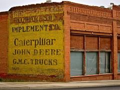 Caterpillar / John Deere painted sign, Harrington, WA (Curtis Cronn) Tags: signs abandoned caterpillar johndeere oldsigns easternwashington paintedsigns harringtonwashington