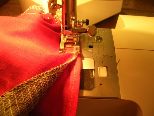 Applying sleeves by machine is often sturdier than hand-finishing them at the end of jacket construction.