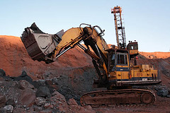 Hydraulic shovel excavating iron ore in a mine-2 (sanmang610) Tags: india industry horizontal bench landscape rocks iron mine industrial machine mining hills machinery mines machines shovel benches karnataka ore excavator hydraulic bellary equipments haematite