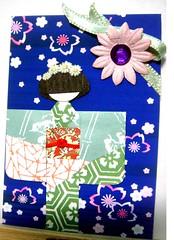 ATC50 - Surrounded by flowers (tengds) Tags: flowers blue green atc kimono ribbon jewel papercraft japanesepaper washi ningyo handmadecard japanesedesign chiyogami japanesepaperdoll origamidoll tengds origamiwashi