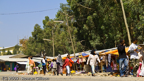 Shoppers and merchants line the side of the road in a market area of Addis Ababa, Ethiopia..