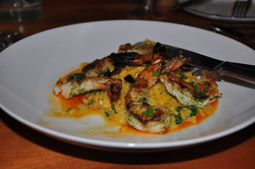 Heres Moonens grilled shrimp with paella dressed with chorizo oil.