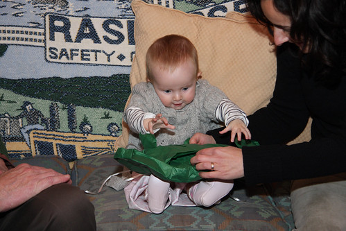Nora unwrapping Christmas present