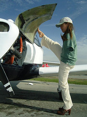 Checking under Cowling (alljects) Tags: woman feet plane flying with arms jessica aviation cox armless without pilot services motivational