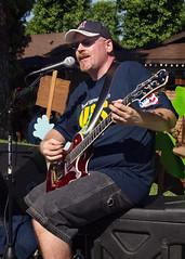 Warming up for the Parade (claimsman) Tags: musicians guitar guitarplayer floatsparadelaverneca