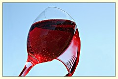 Red on Blue (Richard Cowdrey) Tags: red glass canon eos wine liquid 400d richardcowdrey