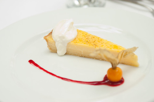 Glazed lemon tart creme fraiche raspberry puree