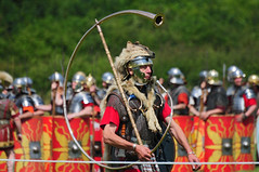 Roman Army Soldier Cornicen (Re-enactor) Marching, Ermine Street Guard, Kelmarsh Festival of History 2009 (Steve Greaves) Tags: red italy rome leather silver walking army gold march italian ancient war uniform catchycolours dress arms roman juliuscaesar sandals military helmet battle explore event instrument marching sword conflict soldiers historical shield recreation horn armour period invasion reenactment troops romanempire reenactors authentic legion romans invading armoury reconstruction cornu invaders cohort legionary spear headdress headgear livinghistory reenacting warfare breastplate englishheritage wolfskin kelmarsh erminestreetguard gladius battledress explored kelmarshhall paxromana cornicen nikond300 fightingforce 43ad