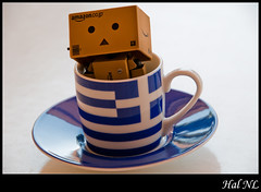 "Danbo: ""...seriously, in a cup..?"" (Hal NL) Tags: blue white cup toy toys nikon flag athens greece figurine d300 yotsuba danbo revoltech jfigure danboard"