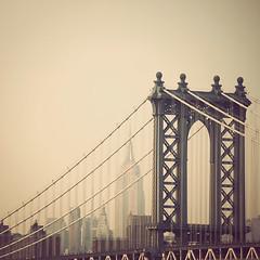 First, we take Manhattan (IrenaS) Tags: nyc bridge urban newyork skyline architecture cityscape manhattan manhattanbridge empirestatebuilding