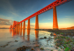 Forth rail bridge in the evening sun (Semi-detached) Tags: bridge 2 sky cloud water rock clouds landscape evening scotland rocks edinburgh south mary rail estuary queen forth shore qm2 lothians cunard hdr lothian firth queensferry