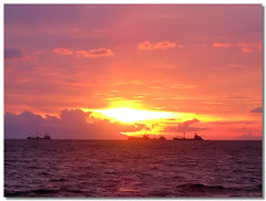 to the next port of call (jaraos) Tags: sunset red sea sky cloud seascape nature water port bay harbor waves skies ship horizon philippines vessel commercial manila merchant goldstaraward flickrestrellas