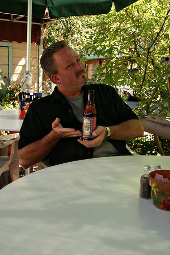 Calvin, modeling for us his favorite beer (Fat Tire), on The Deck at Snowmass Village.