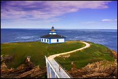Faro de Isla Pancha (Pilar Azaa Taln ) Tags: sea sky espaa lighthouse seascape faro mar spain galicia cielo lugo ribadeo islapancha pilarazaataln copyrightpilarazaataln