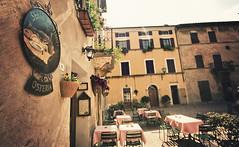 Pienza - Piazza di Spagna (manlio_k) Tags: sun canon vintage square restaurant sigma tuscany tables pienza 1020mm manlio 400d manliok