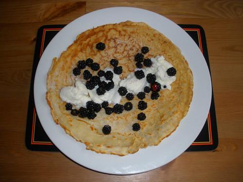 Pancake with vanilla ice cream and blackberries