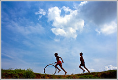 Because I tasted freedom II [..Savar, Bangladesh..] (Catch the dream) Tags: blue boy sky motion game childhood wheel clouds rural children toy village play action bongo rustic run leisure posture playtime pastoral boyhood bengal bangladesh bangladeshi savar sadullapur gettyimagesbangladeshq2