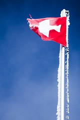 The Swiss Flag (toffiloff) Tags: travel blue red sky white mountain cold ice schweiz switzerland frozen october europe suisse wind swiss flag freezing rope pole gradient torn flagpole cloudless flagg 2009 interlaken 007 sveits jamesbond highaltitude swissflag schilthorn whitecross 3000m canoneos5dmarkii hoyapro1cplfilter canon24105mmf40lis sveitsisk