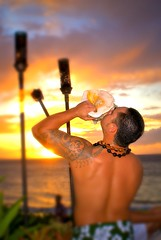 Ceremonial Torch Lighter (chrisbdesign) Tags: ocean sunset man water tattoo outside outdoors fire hawaii bay photo sand surf sony shell maui torch alpha dslr fairmont conch a100 wailea maalea