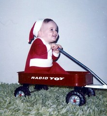 My Son & his Dimple in a Radio TOT Red Wagon ~ Christmas 1972 (Pixel Packing Mama) Tags: aww oldfamilyphotosset mysonset pixelpackingmama dorothydelinaporter worldsfavorite views25pool 125viewspool 25views50pool reallyunlimited bigsmilespool redrulepool redclothespool christmastime1970sset usaunitedstatesofamericapool kidsandtheirkodakmomentspool 2550viewspostupto5perdaypool alookbackwardpool exclamationpointspool reallyunlimitedpool smilespool christmasmemoriespastandpresentpool hatsregrettableandotherwisepool anythingonwheelspool wheelsoffortunepool noelnewyearchristmasyeniyilpool christmasaroundtheworldpool christmaspast19701989pool 70spool original1970spool views2650pool favupset redmaniapool dimplesgalorepool favoritedpixvoliii~2ndhalfof2009set photosfromthe1970spool christmasallyearlongdiscussshapool christmasworldwideflickrs1xmaspool redsantaoutfitredsantahat christmasinthe70spool digtheseventies3inchlongshagcarpet moved123109fromfavupsettofavoritedpixvoliii~2ndhalfof2009set onemillionsmilespool pixelpackingmama~prayforkyronhorman oversixmillionaggregateviews over430000photostreamviews