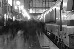 Commuters arriving at Gare du Nord (quadriman brother) Tags: street morning travel blackandwhite bw motion blur paris france station train photography nikon europe gare candid railway rush hour commute garedunord 2009 nord d90 nikond90bw