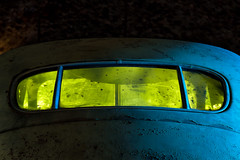 rear window. eldorado canyon, nv. 2016. (eyetwist) Tags: eyetwistkevinballuff eyetwist night rearwindow dirty patina 1946 cadillac sedan techatticupmine eldoradocanyon nelson nevada abandoned ruins dark longexposure long exposure fullmoon desert nikon d7000 nikkor capturenx2 18200mmf3556gvr 18200mm npy nocturne highdesert americana americantypology american typology dead derelict decay nv shadow mojavedesert ruin lightpainting old vintage rust rusty southwest techatticup mine ghosttown touristtrap coloradoriver carmageddon barn car auto yellow blue headliner window glass grime peeling paint classic wheels