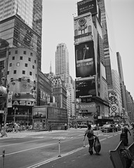 Times Square (spiggycat) Tags: street nyc newyorkcity blackandwhite bw 120 mamiya film buildings mediumformat broadway timessquare gothamist 6x7 grainy 67 expiredfilm 65mm mamiya7 mamiya7ii