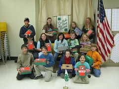 South Shore 4-H club displays festive boxes of small toys, school supplies, and gifts compiled for a Christmas project. The boxes were then shipped to destitute children overseas.