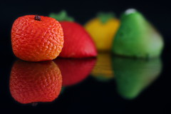 still life with marzipan:  246/365 (helen sotiriadis) Tags: red food orange black macro reflection green yellow closeup canon lemon strawberry dof candy fig bokeh almond depthoffield marzipan 365 canonef100mmf28macrousm canoneos40d toomanytribbles