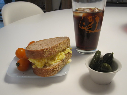 Egg sandwich, tomatoes, pickles, Diet Coke at home