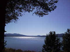 A place to sit and dream (peggyhr) Tags: blue trees friends light sky usa mountains water sparkles oregon silhouettes sunny diamondlake troutfishing peggyhr shimmerylight samsungsmartphone snc00395
