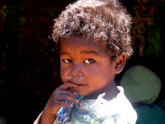 cute kid (Linda DV (back again)) Tags: africa street travel portrait people food cute face canon children geotagged kid child market candid young kind enfant madagascar 2009 antsirabe travelphotography travelportrait powershots5is lindadevolder asabotsy
