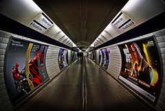 Going Deeper Underground [EXPLORED] (Aaron Yeoman) Tags: uk greatbritain travel roof england people urban white signs london lines station sign architecture modern underground tile vanishingpoint lomo lomography europe metro unitedkingdom sony curves tube perspective tunnel line explore tiles advert gb tubestation londonunderground alpha curve a200 vignette piccadillyline northernline adverts undergroundstation explored leicestersquaretubestation sonydt1870mmf3556 sonya200 bestcapturesaoi leicestersquareundergroundstation