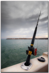 Trolling (BQ8) Tags: blue light sea sky white bird beach broadcast rain birds clouds lights bay coast fishing nikon exposure waves gulf guard craft sigma line explore master land yamaha rod troll kuwait af polar nikkor 1020 bashar q8 liner multiply trolling   d300s bq8
