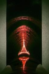 Tiki Monolith... (Sea Moon) Tags: red symmetry obelisk refraction cenotaph caustics tikiface2001