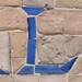 L blue on beige mosaic