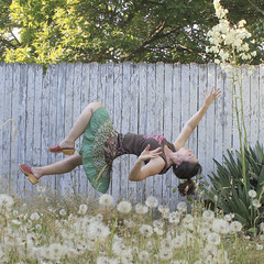Float and Flowers (Agent Cooper) Tags: flowers summer girl fence floating levitation dandelion illusion tanktop ponytail anticipation float ascension ascend levitate