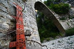 0 for now (Elios.k) Tags: bridge red metal stone river rust arc dry wideangle hike greece meter depth zagori voidomatis  kokkoris     eikoneselladas
