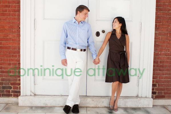 engagement photo standing in front of door