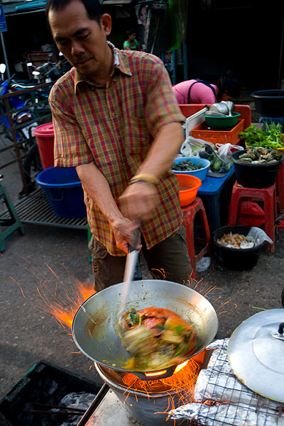 Frying up curry crab at Hat Yai's evening market