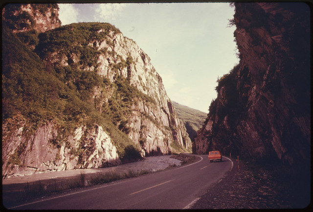 Inside Keystone Canyon Looking South Along the Richardson Highway The Cliffs at the Left Climb More Than 1000 Feet Above the Rushing Waters of the Lowe River Mile 766 near the Alaska Pipeline Route 081974 by The US National Archives