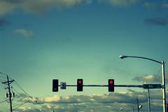 2009-09-22_061_xpro (Asbestos Bill) Tags: sky art clouds digital trafficlight xpro streetlamp streetlights photoshopped telephone grain pole powerlines stoplight trafficsignal fauxcrossprocess