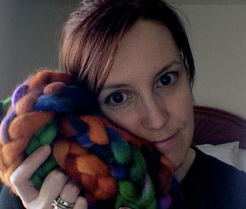 Nuzzling some of my own dyed-by-me roving I am donating as a raffle prize