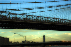 Moon between Brooklyn and Manhattan Bridges (jackie weisberg) Tags: city nyc newyorkcity bridge sunset sky urban usa moon ny newyork horizontal skyline architecture brooklyn skies suspension manhattan cities cityscapes bridges bluesky cable historic cables photograph american moonrise nightime brooklynbridge manhattanbridge borough newyorkstate moons blueskies northeast span bigcity nys spans thebigapple 718 kingscounty jackieweisberg moonarising