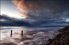 Rain over Dornoch (angus clyne) Tags: morning sea snow seaweed cold beach wet rain clouds dawn scotland highlands stones sunday north wave pebbles east kelp posts sutherland dornoch sleet broch flikcr golspie flotsamjetsam brora dornochfirth nohdr leefilters carnliathbroch