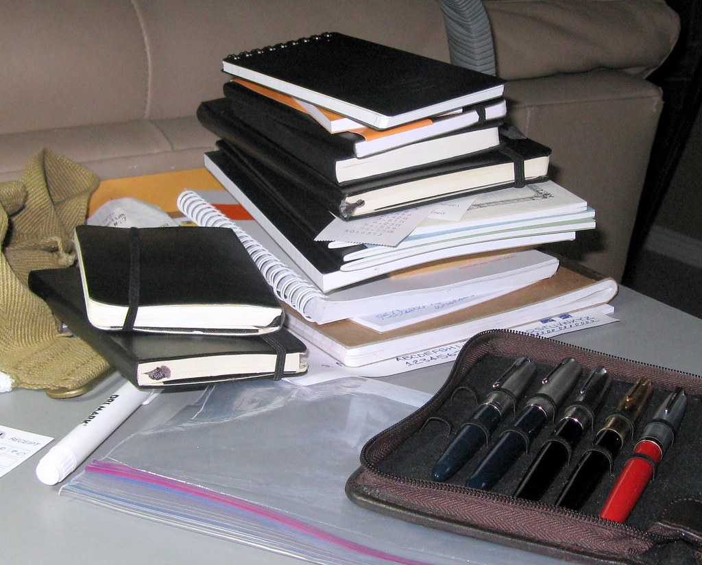 Pile of Notebooks and Fountain Pens